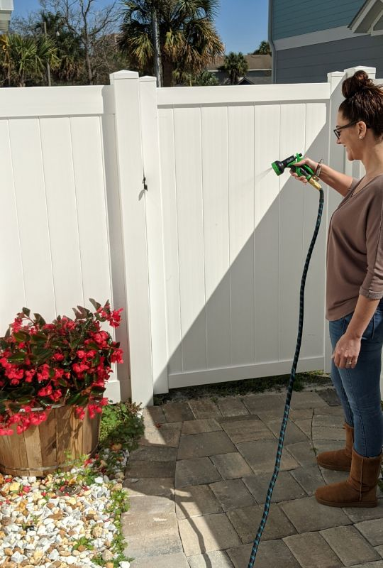 Heather Watering Her Flowers