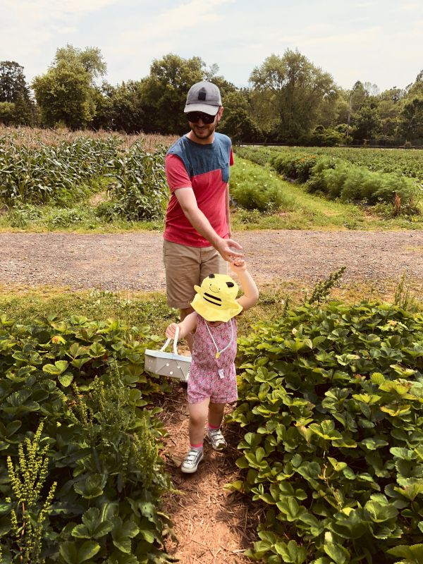 Brian & Olivia Picking Strawberries