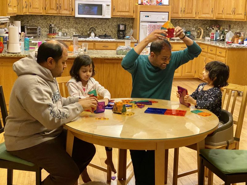 Amit Engineering a Hat From Magnetic Tiles With His Nieces
