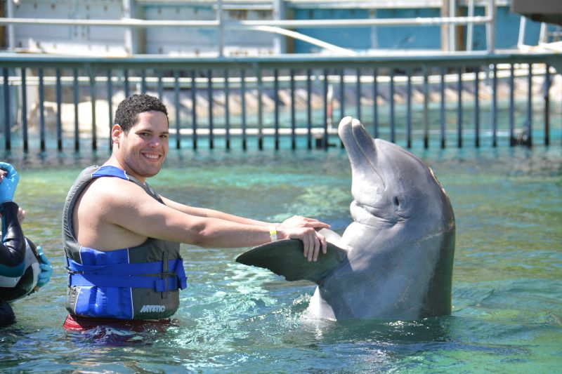 Carlos Accomplishing His Dream of Playing with a Dolphin