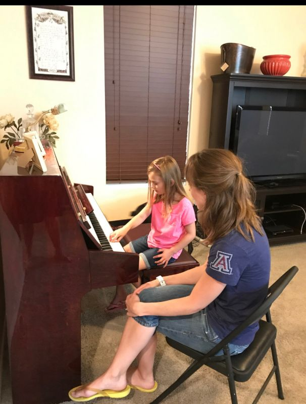 Erin Teaching Piano Lessons
