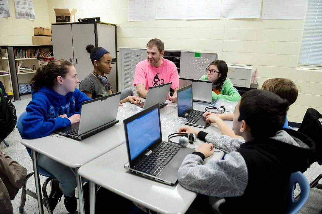 Brandon Helping Students