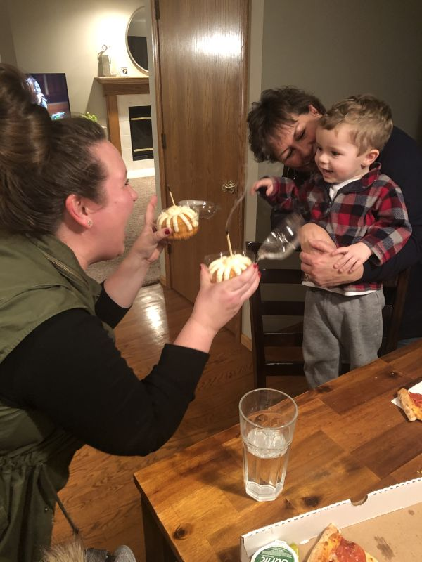 Mason Helping Morgan Blow Out Her Birthday Candles with Grandma