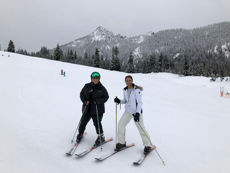 Laura Skiing with a Friend