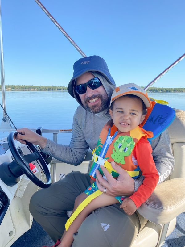 Helping Uncle Frank Drive the Boat