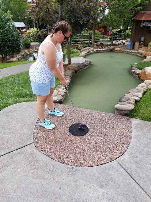 Playing Miniature Golf