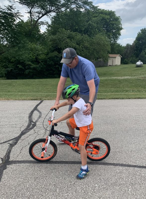 Helping Our Friends' Son Learn to Ride His Bike