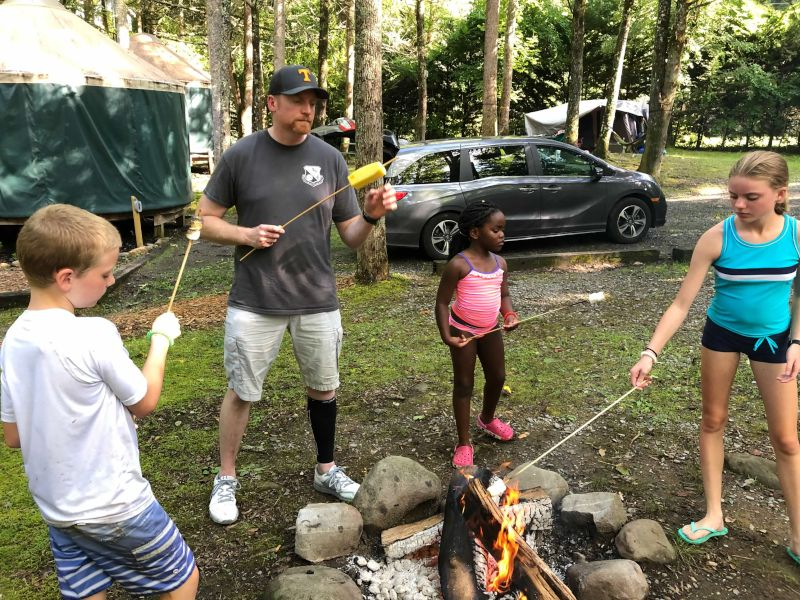Making S'mores Around the Camp Fire
