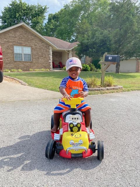 Beau Riding His Car
