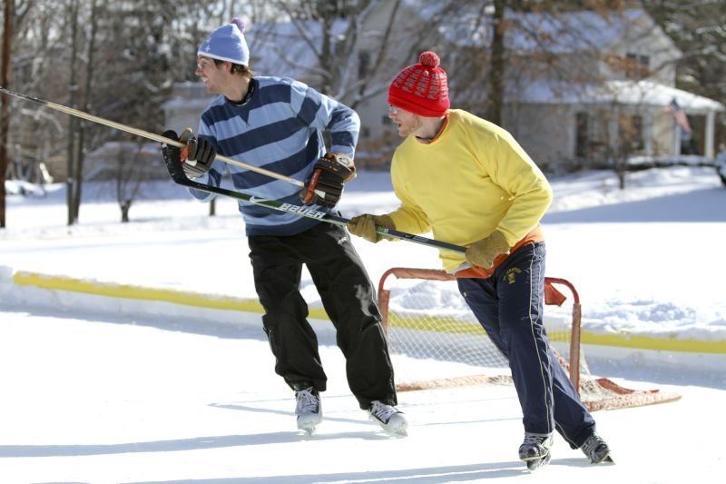 Drew & a Friend Playing Pond Hockey