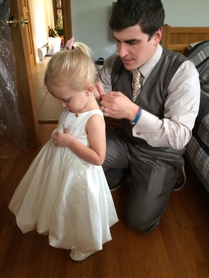 Eric Helping Catalina Get Ready to Be a Flower Girl