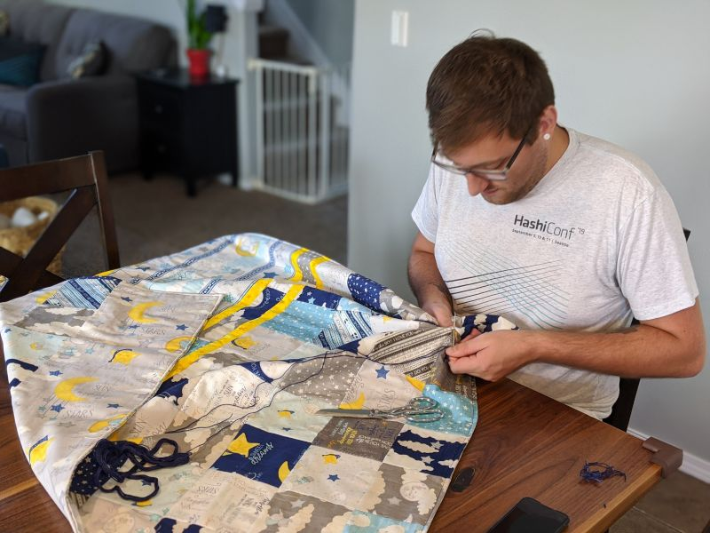 Ethan Making a Baby Blanket for Our Nephew