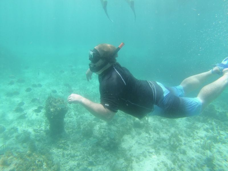 Andrew Looking for Tropical Fish While Snorkeling in the Ocean