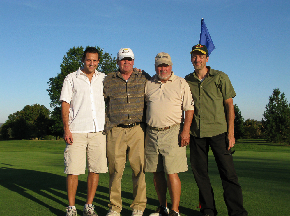 Tom Golfing with His Dad, Brother and Uncle