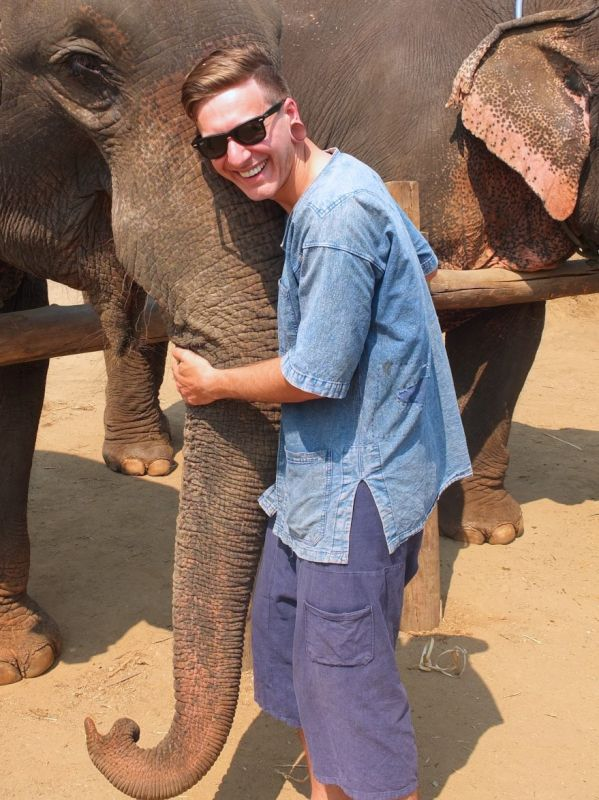 Kyle Hugging an Elephant in Thailand