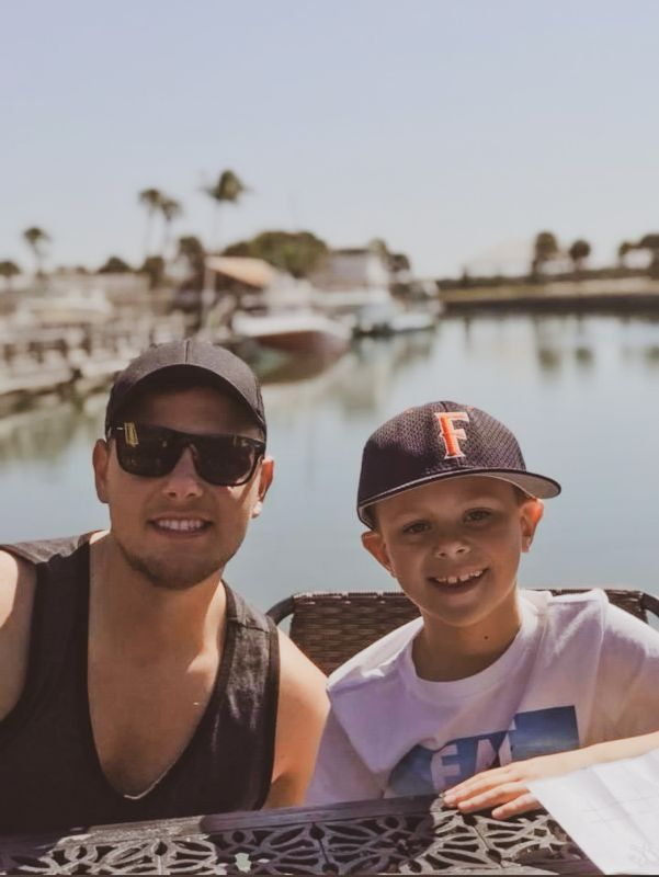 Trevor & Our Nephew Hanging Out at a Favorite Beachside Restaurant in Florida