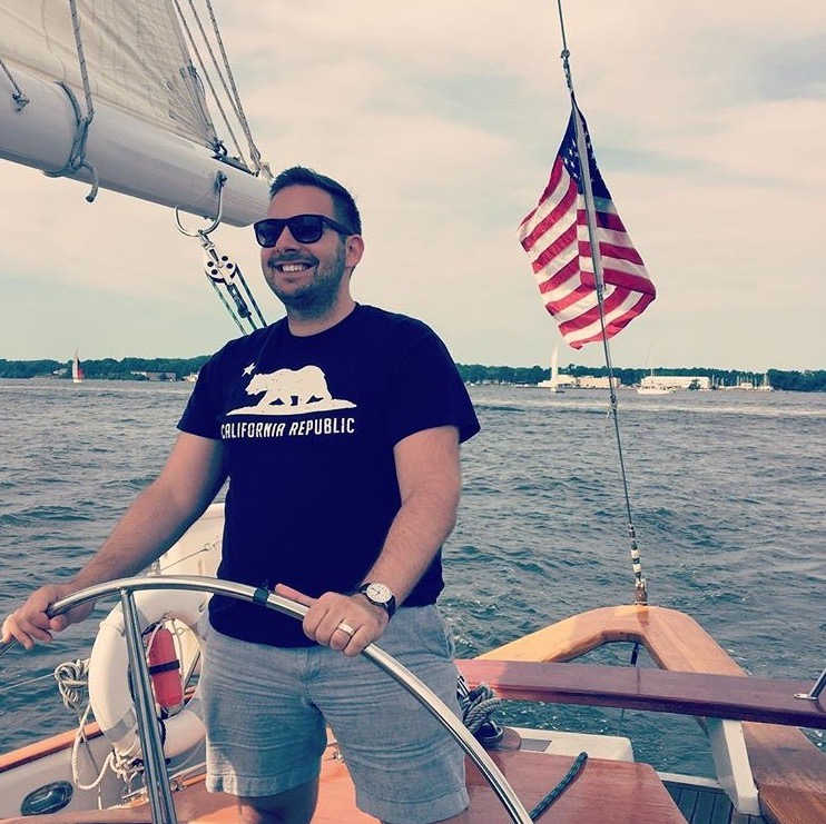 Captain Nick Taking a Spin at the Wheel During a Cruise on Chesapeake Bay