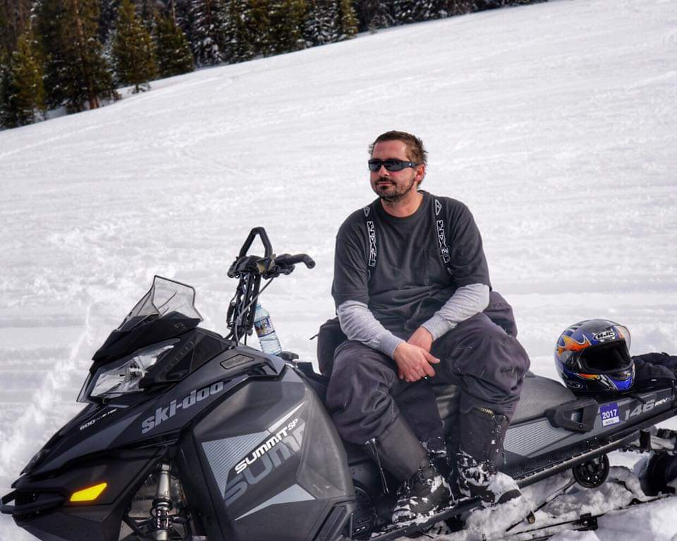 Kevin Taking a Break From Snowmobiling