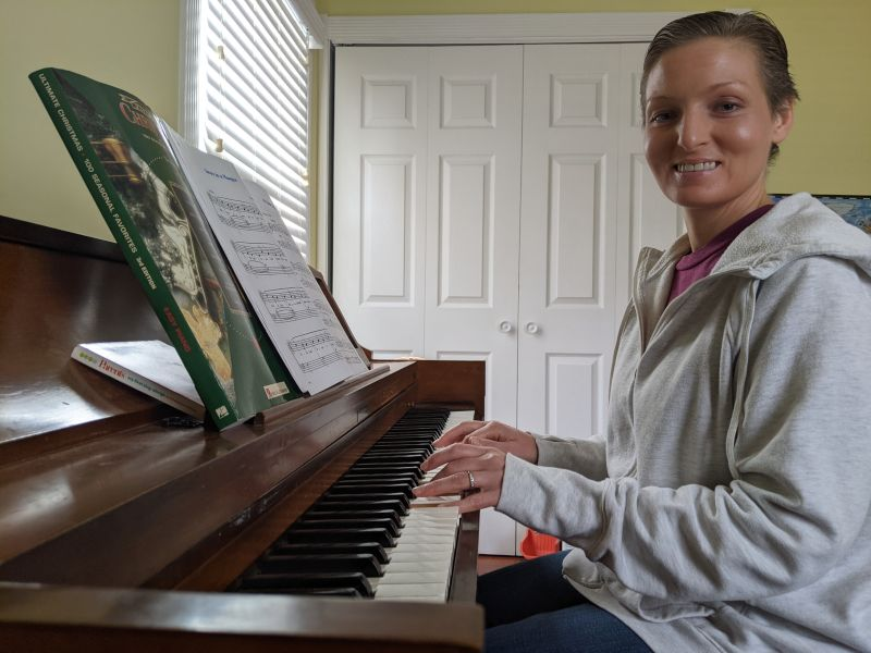 Terri Practicing Christmas Songs on the Piano