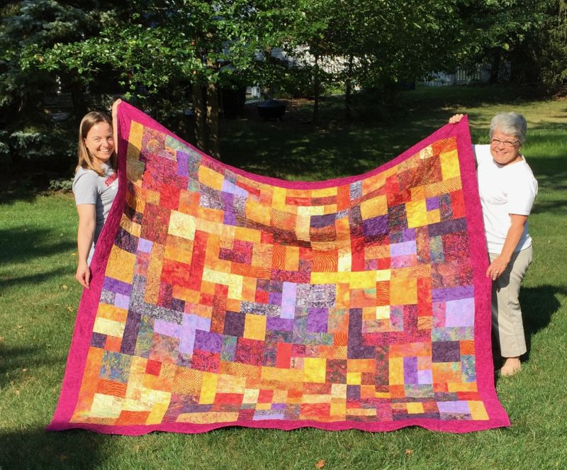 Holding One of Elizabeth's Quilts