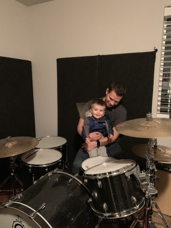 Teaching Our Nephew How to Drum