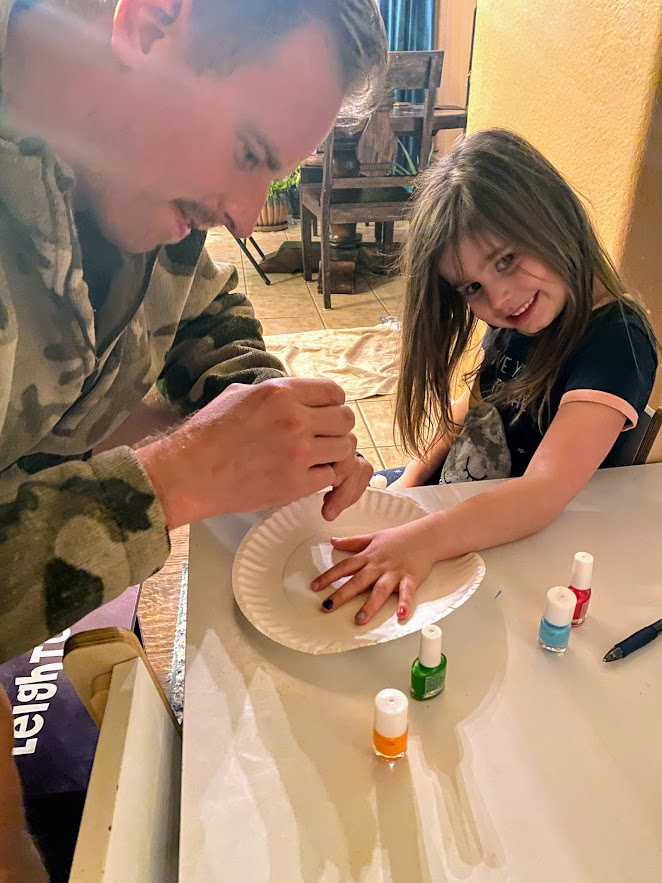 Andy Painting His Niece's Nails