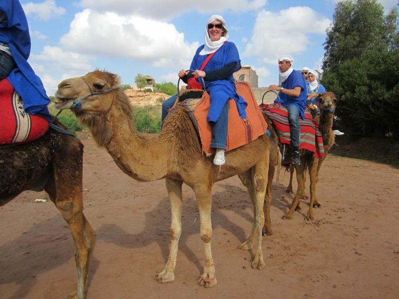 Alison Riding a Camel in in Morocco