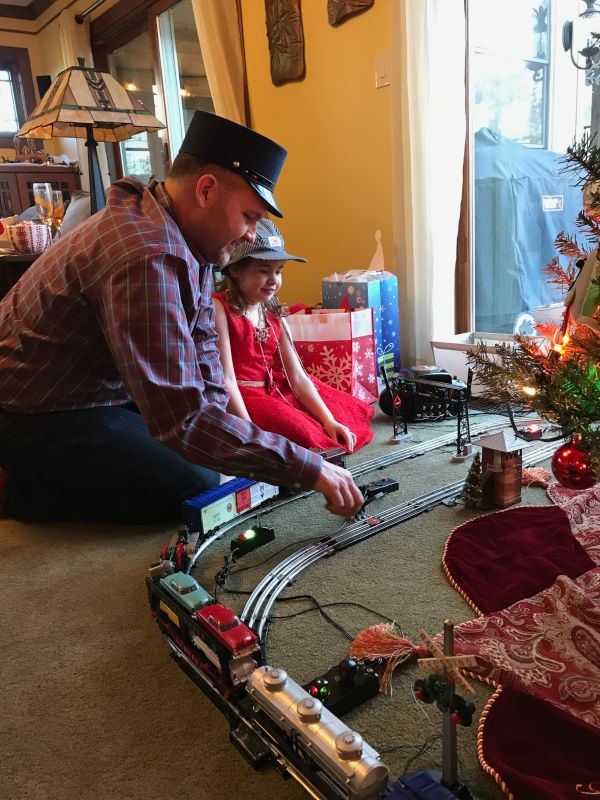Matt and Our Niece Playing Trains