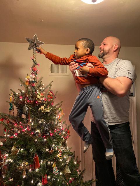 Corey & Kian Placing the Star on the Tree