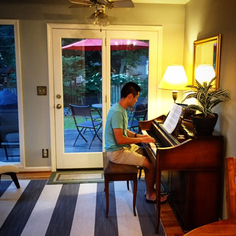 Chris in the Sun Porch Playing His Childhood Piano