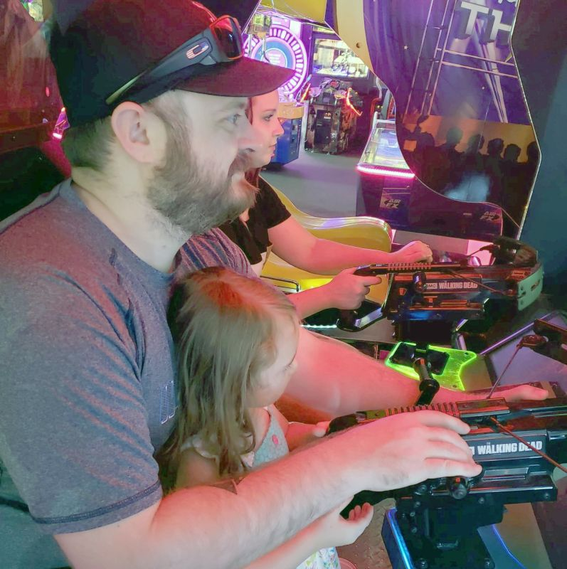 At the Arcade With Our Niece