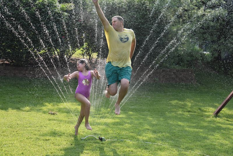Molly and Nick Being Silly in the Sprinklers