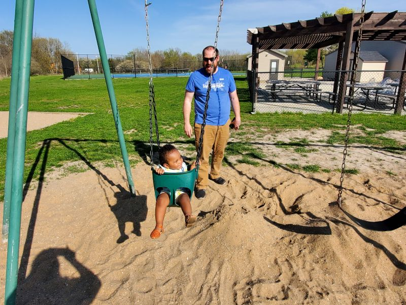 Swingset at the Playground With Dad